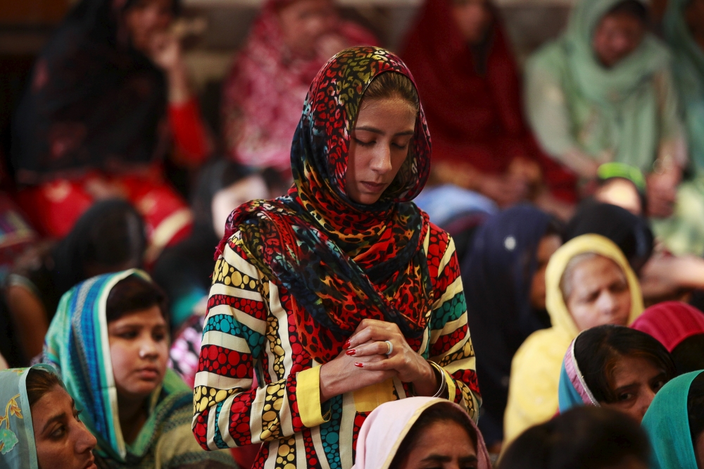 Christians attend a Good Friday prayer at the Saint Anthony Church in Lahore, Pakistan, April 3, 2015.