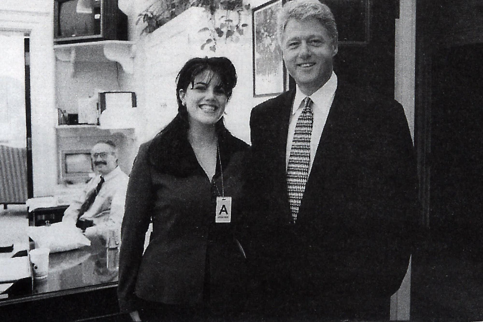 FOR SUNDAY Official White House photo taken Nov. 17, 1995 from page 3179 of Independent Counsel Kenneth Starr's report on President Clinton, showing President Clinton and Monica Lewinsky at the White House. Congress laid before a wary nation Monday the raw footage of the president's grand jury testimony and 3,183 pages of evidence chronicling his relationship with Monica Lewinsky in explicit detail. (AP Photo/OIC)