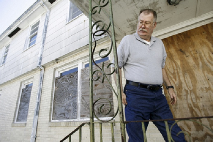 Tuesday April 7, 2009 Robert Hoobler, a former New Orleans Police officer, stands in front of the apartment where Grammy-winning musician Lil' Wayne once lived in the Hollygrove area of New Orleans.  It is the same home where Hoobler carried out a bloodied Lil' Wayne after he was shot when he was 12 years old. Hoobler saved Lil' Wayne's life by driving him to a nearby hospital.