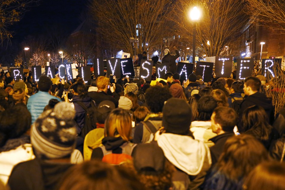 "Demonstrators hold up lighted signs spelling out ""Black Lives Matter"" during a protest in Boston, Massachusetts, November 25, 2014.  Hundreds of protesters marched through Boston one day after Missouri police officer Darren Wilson was not charged for the fatal August shooting of the unarmed black teenager Michael Brown in Ferguson, Missouri. REUTERS/Brian Snyder (UNITED STATES - Tags: CIVIL UNREST CRIME LAW) - RTR4FM1E"