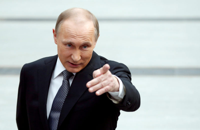 Russian President Vladimir Putin gestures as he speaks during a meeting with journalists after a live broadcast nationwide call-in in Moscow