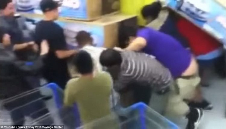 Meanwhile, shoppers broke into an all-out melee at a Walmart in Houston on Black Friday, as customers battled it out for some $99 kiddie convertibles.