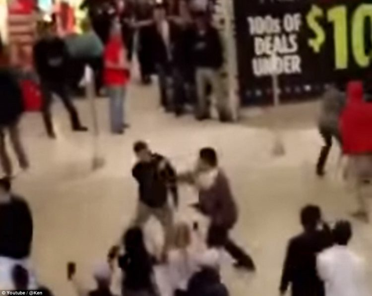 At a mall in California, a crowd was seen gathering around two men as they appeared to exchange blows during Black Friday shopping.