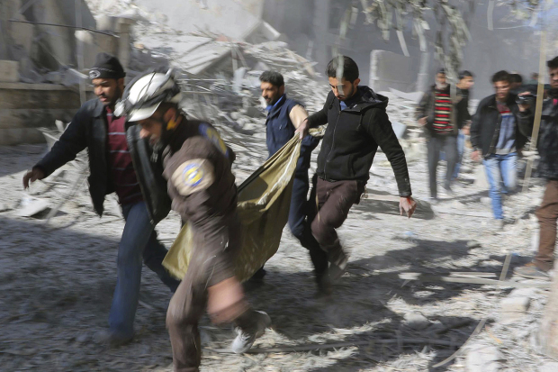 This photo provided by the Syrian Civil Defense White Helmets, which has been authenticated based on its contents and other AP reporting, shows Civil Defense workers and Syrian citizens carry a dead body in the neighborhood of Seif al-Dawleh in Aleppo, Syria, Saturday, Nov. 19, 2016. Government bombardment of besieged rebel-held neighborhoods in the northern city of Aleppo killed at least 20 people Saturday Syrian opposition activists said, a day after the health directorate said all hospital in opposition areas have been knocked out of service. (Syrian Civil Defense White Helmets via AP) øøø øøøøøø