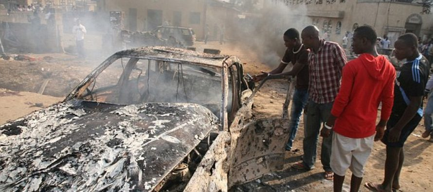 Female suicide bomber with baby strapped to her back blows herself up inside a busy market killing six
