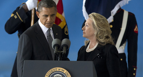 President Barack Obama and Secretary of State Hillary Rodham Clinton stand at the podium as they attend a Transfer of Remains Ceremony, Friday, Sept. 14, 2012, at Andrews Air Force Base, Md., marking the return to the United States of the remains of the four Americans killed this week in Benghazi, Libya. (AP Photo/Carolyn Kaster)