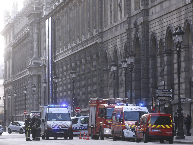 Police and Pompiers deployed to the Louvre / AP Images