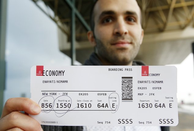 Just hours after an appeals court blocked an attempt to re-impose the travel ban, Iranian researcher Nima Enayati checked in on an Emirates Airline flight direct from Milan