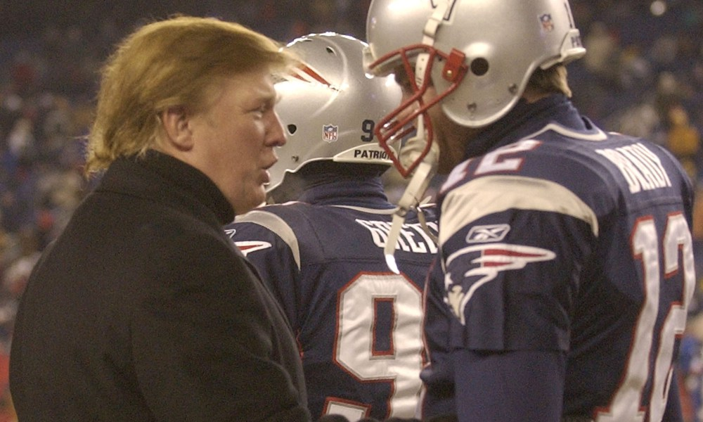Donald Trump, left,  stops to talk to New England Patriots quarterback Tom Brady prior to the start of the game at Gillette Stadium, Saturday, Jan. 10, 2004, in Foxboro, Mass., where the Patriots will play the Tennessee Titans in a AFC divisional playoff game. (AP Photo/Elise Amendola) ORG XMIT: FBO105