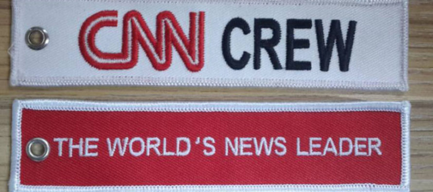OMG! Baggage Handlers Leave AMAZING Stickers on CNN Cameraman's Luggage