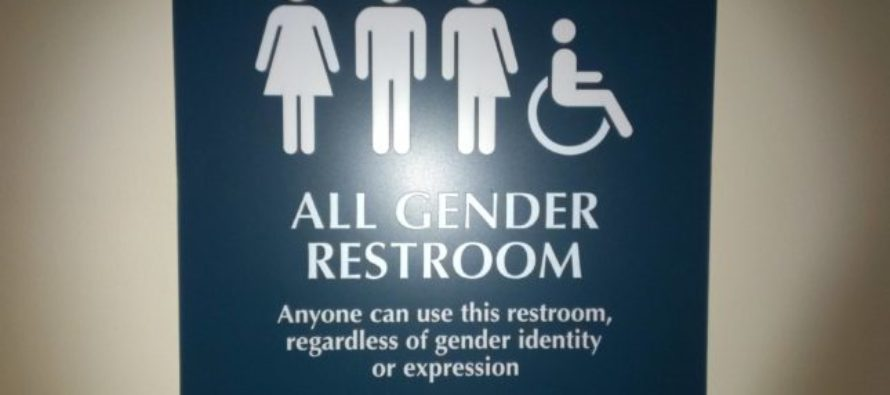 Liberal Mom frightened at what walks in the women's room behind her