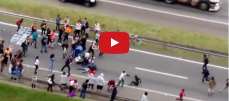 Angry Driver PLOWS THROUGH Protesters Blocking Highway [VIDEO]