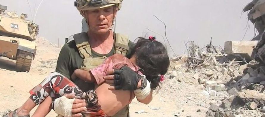 HEROIC Aid Worker Faces ISIS Gunfire To RESCUE Child Hiding In Pile Of Dead Bodies [VIDEO]