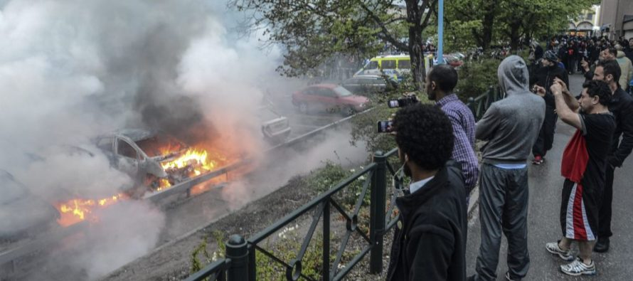 Police In Sweden Are Targeted By 100 Masked Migrant Youths!