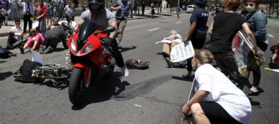 WATCH Biker STEAMROLL Through Anti-Trumpers Blocking Streets In Protest!