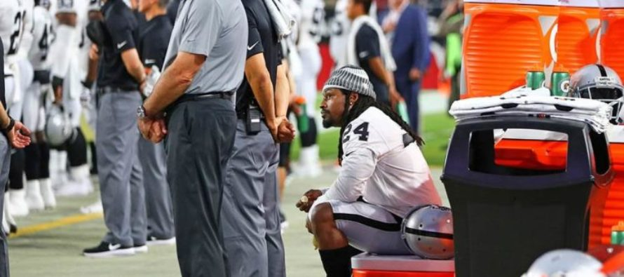 NFL Running Back Marshawn Lynch Sits During National Anthem