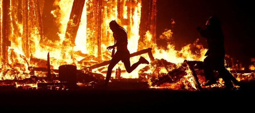 Burning Man Festival Reveler Evades Several Rangers To Jump Into Flames Of Burning Effigy
