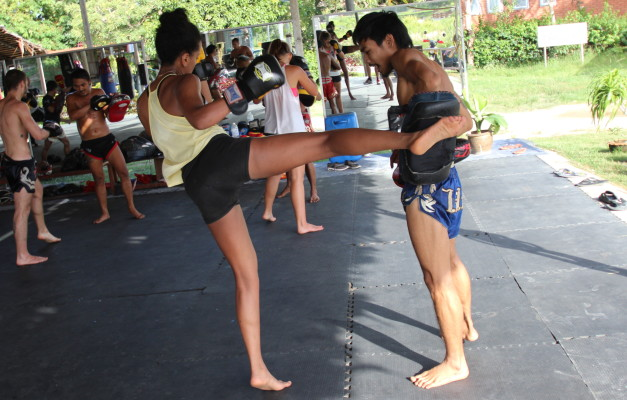 Little girl asks to be hit with a real Thai kick. She gets her wish