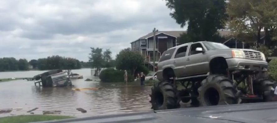Army Vehicle Gets Stuck In Harvey Floodwater, Until A MONSTER Truck Shows Up! [VIDEO]