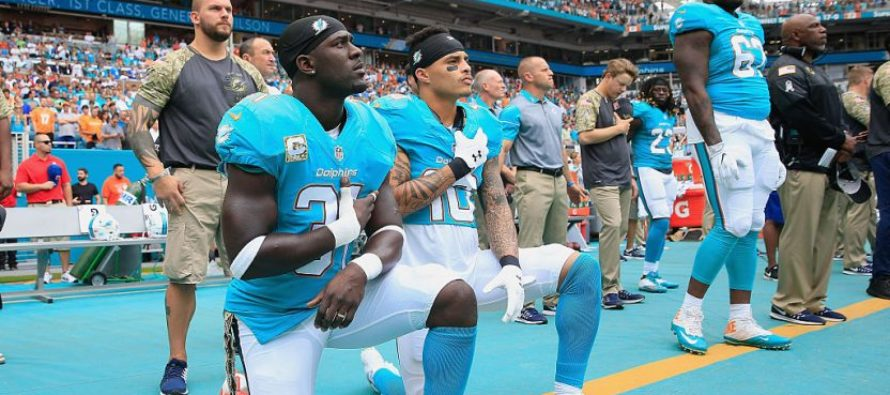 3 Dolphins Take A Knee For Anthem in London; Saints Kneel for Coin Toss, Stand for Anthem [VIDEO]
