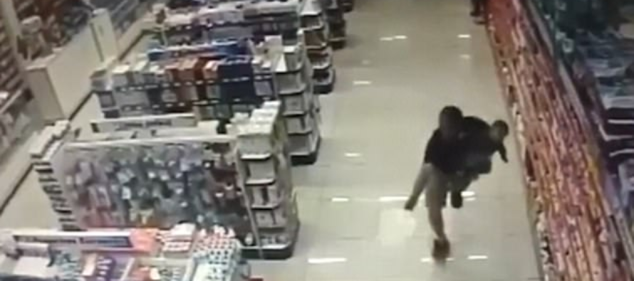 WILD VIDEO: Off-duty cop shoots two gunmen dead while clutching his BABY boy in the other hand